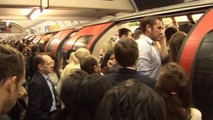 People struggling to get on a Central Line train on Tuesday morning