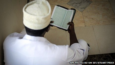 A delegate reading the Koran at the National Conference on Tackling Extremism in Somalia - September 2013