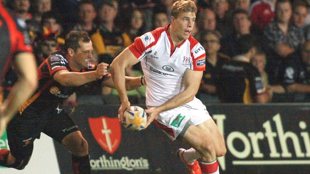 Dragons player Dan Evans closes in on Andrew Trimble in the Pro12 opener