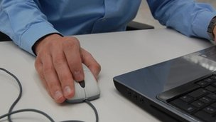 Man using a laptop mouse