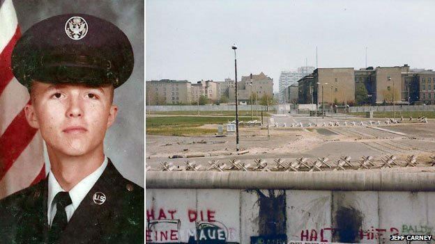 Jeff Carney in uniform and the Berlin Wall. Image from http://www.bbc.co.uk/news/magazine-23978501