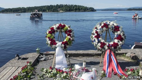 Wreaths to mark the two year anniversary of the massacre, with the island of Utoeya in the background (22 July 2013)