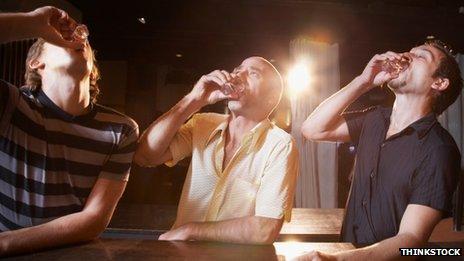 Three men drinking shots
