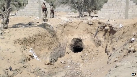 In this image taken from video, Egyptian Army personnel supervise the destruction of tunnels between Egypt and the Gaza Strip at the border, near the town of Rafah, northern Sinai, Egypt, on 3 September 2013.