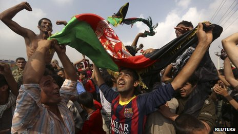 Afghan football fans celebrate winning the South Asian Football Federation championship after their team defeated India during the final match, in the streets of Kabul on 12 September 2013.