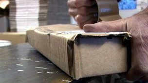Man wrapping a parcel