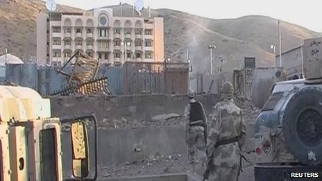 Soldiers walk towards the U.S. Consulate after an attack by insurgents in the western Afghanistan city of Herat, in this still image taken from video on September 13, 2013