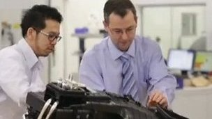 Workers at Denso