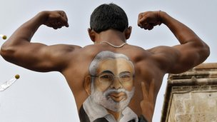 Supporter shows off an image of Narendra Modi on his back (12 July 2013)