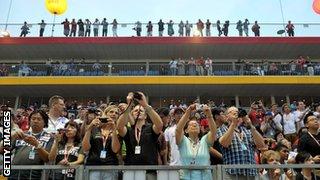 Fans watch the Singapore Grand Prix