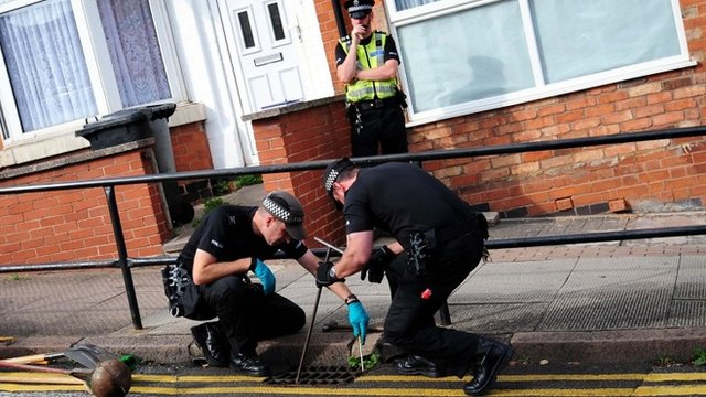 Police making a search near to the scene of a house fire at Wood Hill, in the Spinney Hills area of Leicester, which claimed the lives of four people