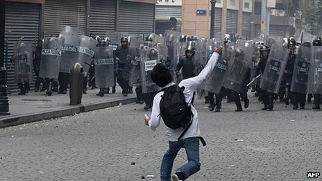 A demonstrator throws stones at Mexican police during a violent eviction of teachers protesting against education reforms, on 13 September