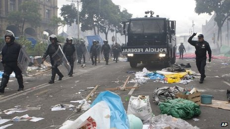 Riot police enter the main plaza, the Zocalo, in a mass eviction operation to remove striking teachers, in Mexico City, 13 September