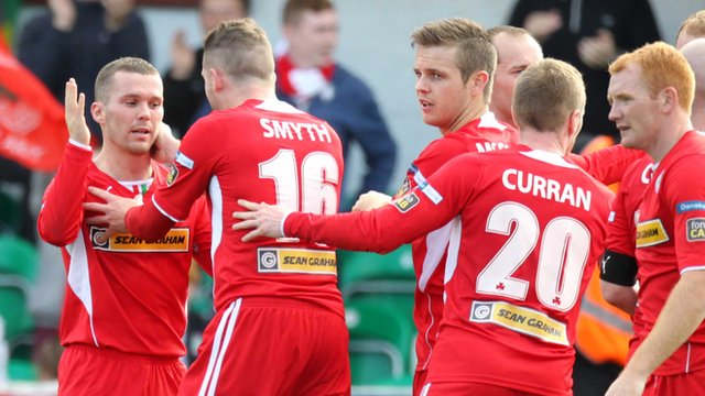 Cliftonville players celebrate victory over Glentoran