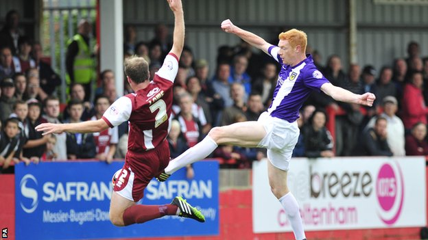 Dave Kitson beats Keith Lowe to the ball