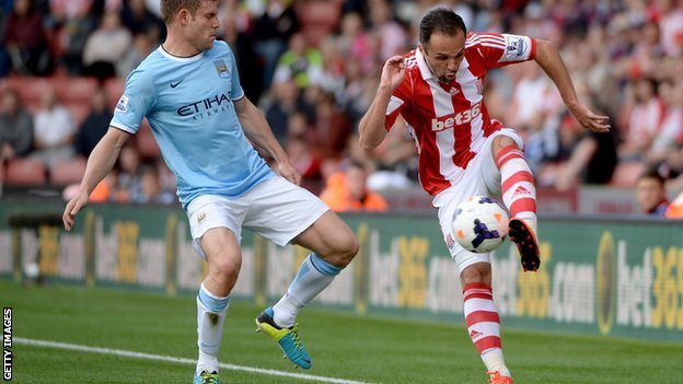 Manchester City's James Milner thwarts Stoke City's Matthew Etherington
