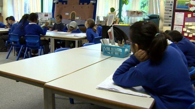 Children in classroom, wearing uniform