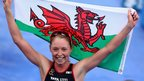 Non Stanford waves the Welsh flag after winning the ITU Triathlon Grand Final in London, and clinching the world title in the process.