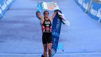 Non Stanford crosses the line to win the ITU Triathlon Grand Final in London and take the world title.