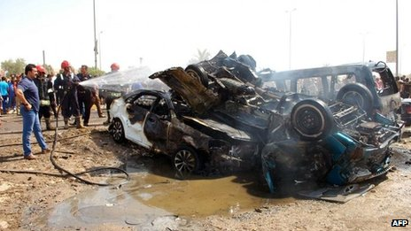 Burnt vehicles at the scene of a car bomb explosion in Nasiriya.
