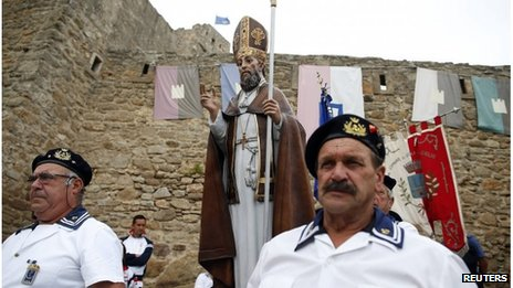 People attend a procession of Saint Mamiliano at Giglio Castle on Giglio Island