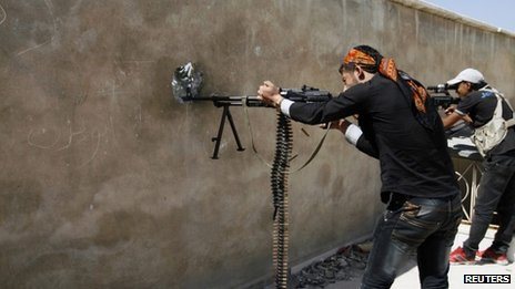Free Syrian Army fighters take a shooting position in Sheikh Khodr area in Aleppo, September 15, 2013