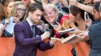 Daniel Radcliffe on the Kill Your Darlings red carpet
