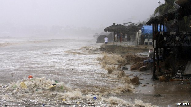 Waves flood a beach in Acapulco on 15 September, 2013