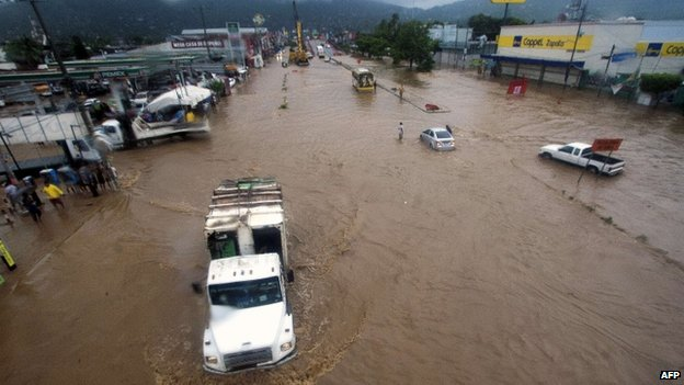View of flooded streets in Acapulco, Guerrero state, on 15 September 2013