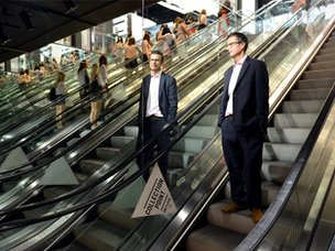 Robert Peston on an escalator