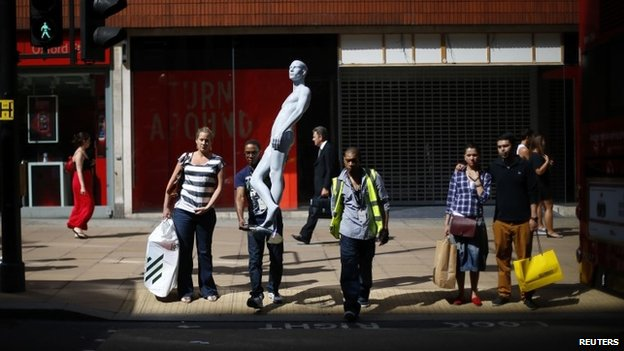 Shoppers and man with mannequin