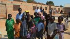 Mark Goldring, CEO Oxfam UK, meeting children at Kasombo Community School