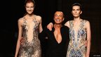 Julien Macdonald acknowledges the audience following his show during London Fashion Week at Goldsmiths Hall on September 14, 2013