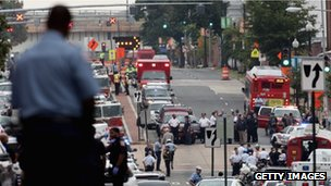 Emergency vehicles and law enforcement personnel respond to a reported shooting at the Washington Navy Yard in 16 September 2013 in Washington, DC.