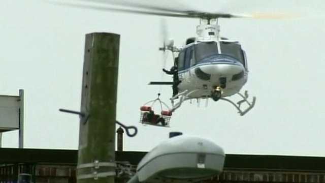 A helicopter winches someone on board