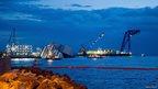Boats surround the Costa Concordia.
