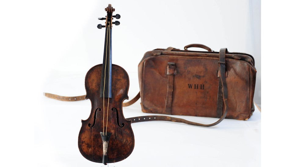 A violin played by bandmaster Wallace Hartley during Titanic's maiden voyage, is to go on show at Titanic Belfast.  The instrument, accompanied by a leather luggage case, will be on display from Wednesday before it goes to auction in October.