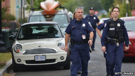 Police officers walk on a street near the navy yard