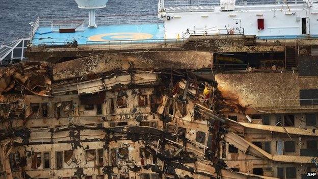 The wreck of Italy's Costa Concordia cruise ship on the morning of 17 September 2013 near Giglio port
