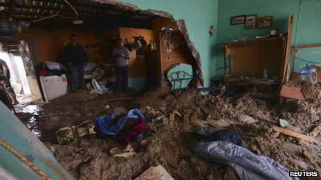 A house flooded by mud after a mountain landslide in Altotonga in Veracruz state on 16 September, 2013