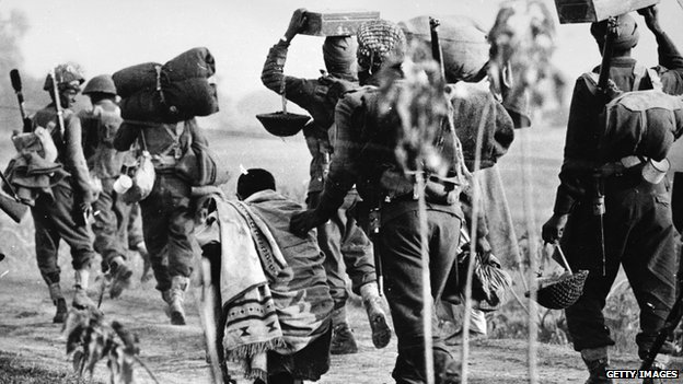 December 1971: An elderly Pakistani refugee is pushed aside by Indian troops advancing into the East Pakistan (Bangladesh) area during the Indo-Pakistani war.