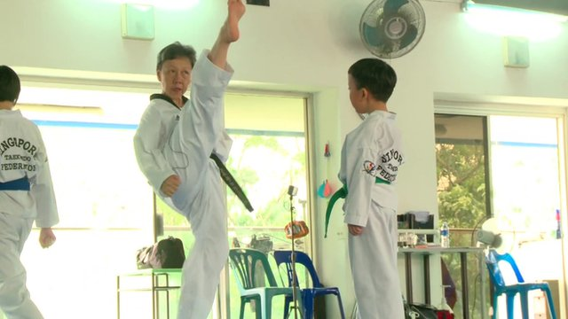 Sister Linda Sim demonstrating a high kick