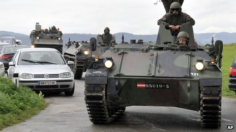 Austrian army soldiers in armoured vehicles arrive at the scene some 90km (55 miles) west of Vienna