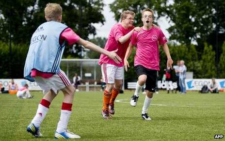 Boys with Down's syndrome playing football