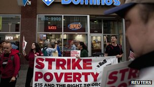 Demonstrators are pictured in front of Domino's Pizza during a strike aimed at the fast-food industry and the minimum wage in Seattle, Washington 29 August 2013