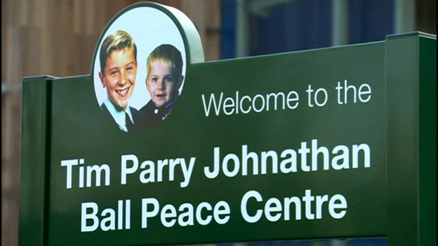 A sign reading Tim Parry Johnathan Ball Peace Centre.