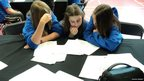 School Reporters Emillia, Cathryn and Jade working hard studying their brief at the Sainsbury's School Games