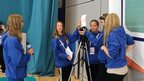 Emillia, Cathryn and Jade practice their filming skills as they make an introductory video with the Youth Media Team.
