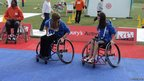 The School Reporters from Tendring Technology College try their hand at wheelchair basketball