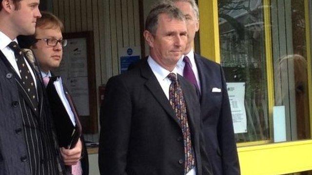 Nigel Evans (centre) wearing a dark suit